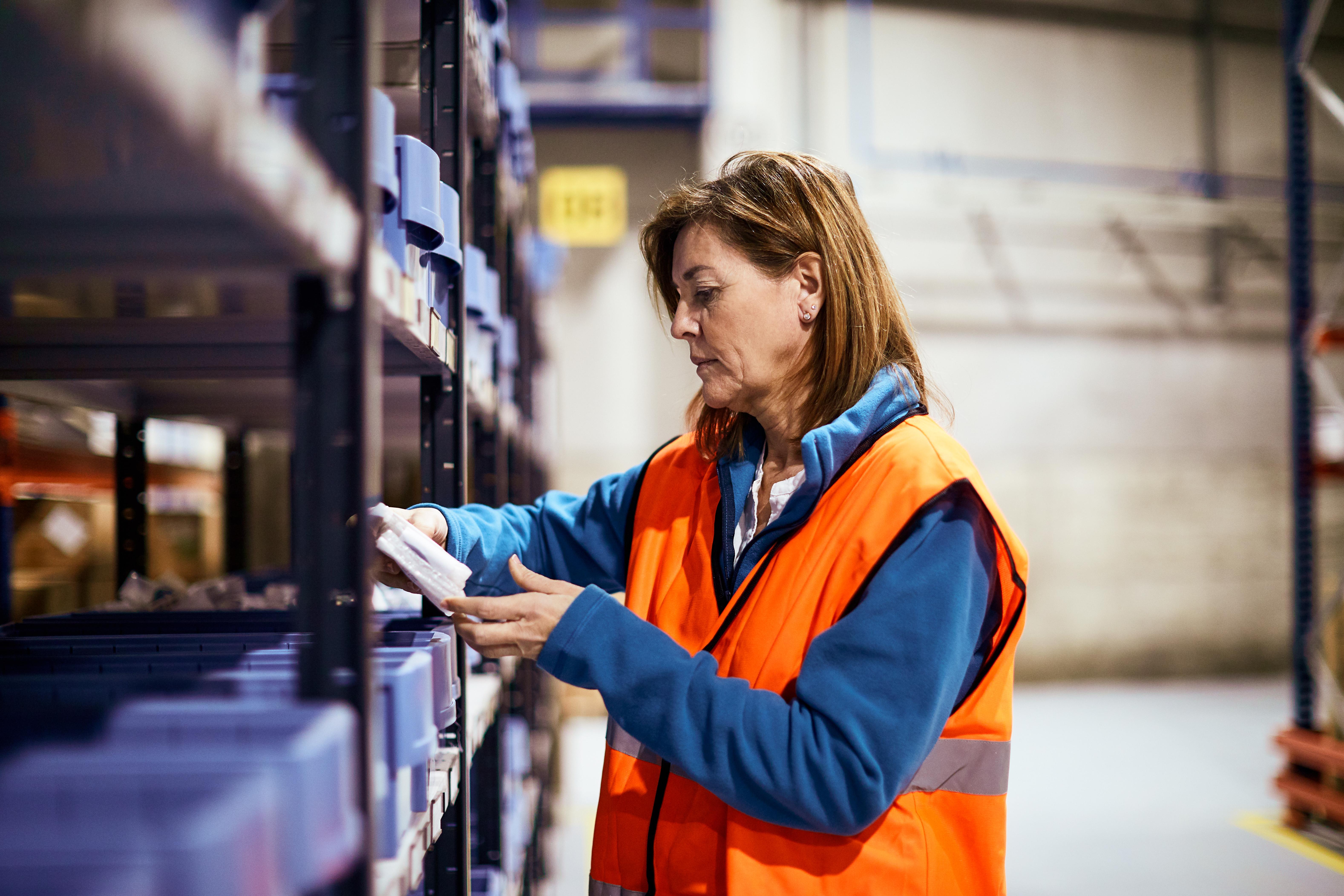 Warhouse employee checking goods